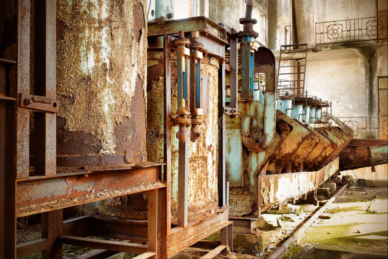 Abandoned factory. Rust-stained machine royalty free stock image