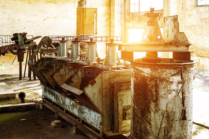 Abandoned factory. Rust-stained machine royalty free stock photography
