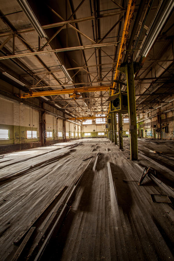 Abandoned factory. Warped floor boards of an abandoned factory royalty free stock photo