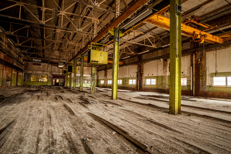 Abandoned factory. Warped floor boards of an abandoned factory stock image