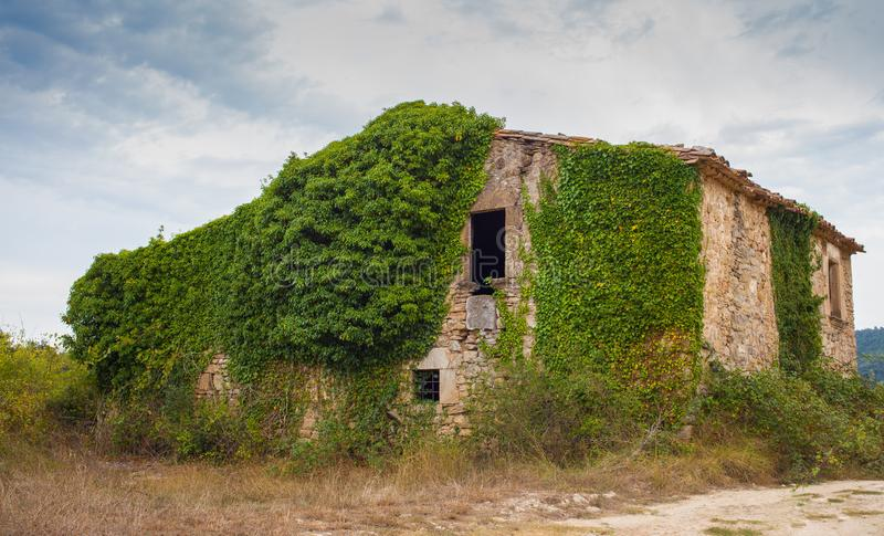 Abandoned farmers house rural decadence. As in may other countries, also in Catalonia, the younger generations have opted to leave their rural homeland behind stock photography