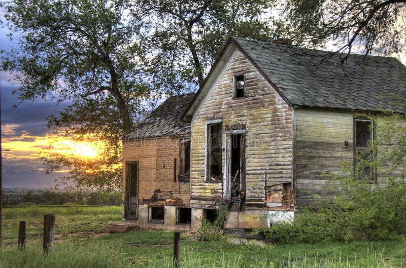 Abandoned Farmhouse. Abandoned Colorado farmhouse during a passing rainstorm royalty free stock photo