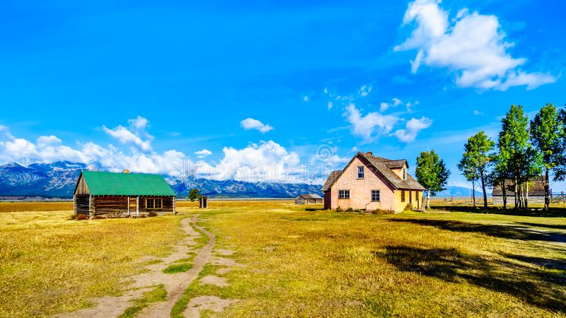 Abandoned Farmhouses at Mormon Row with in the background cloud covered Peaks of the Grand Tetons In Grand Tetons National Park. Near Jackson Hole, Wyoming stock photos