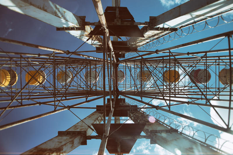 Abandoned ferring wheel. In an old park stock photo