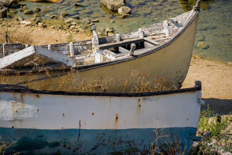 Abandoned fishing boats on land stock image