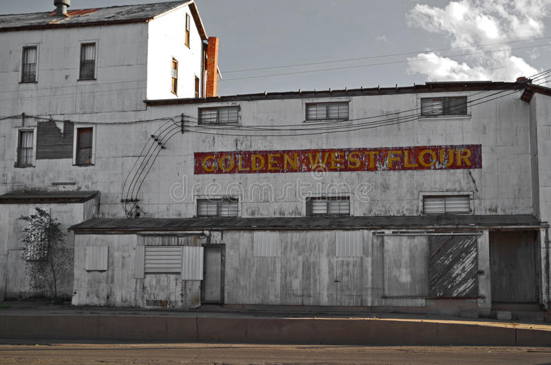 Abandoned Flour Mill in Clovis, New Mexico. Old, abandoned, rusting flour mill in Clovis, New Mexico. Was known as the Golden West Flour Mill stock images