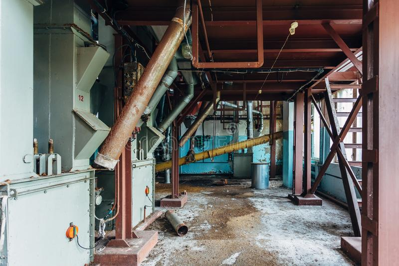 Abandoned flour milling factory. Old rusty grain cleaning air separation machines.  royalty free stock photo