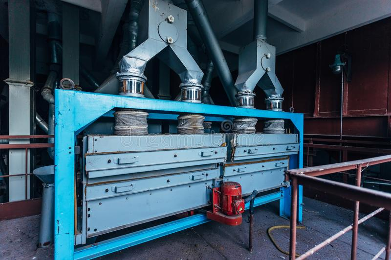 Abandoned flour milling factory. Old rusty grain cleaning air separation machines.  stock image