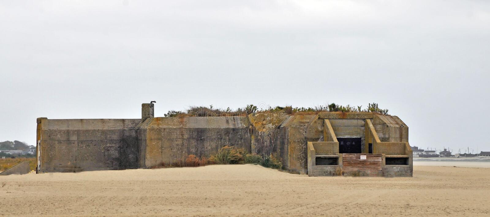 Abandoned Giant On The Beach Cape May, New Jersey. Prior to WWII, the United States strengthened its coastal defenses. One of the forts is Battery 223. Sitting royalty free stock photo