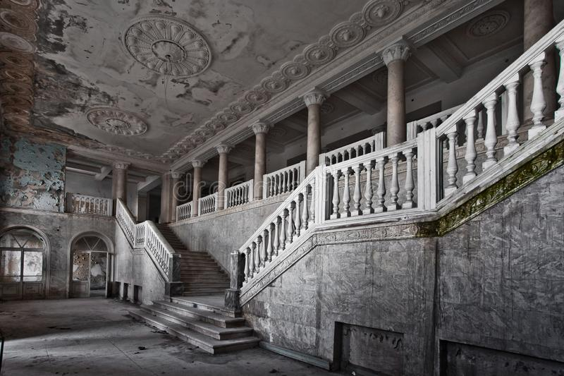 abandoned hall of a rich hotel with columns, the luxury of decline stock photography
