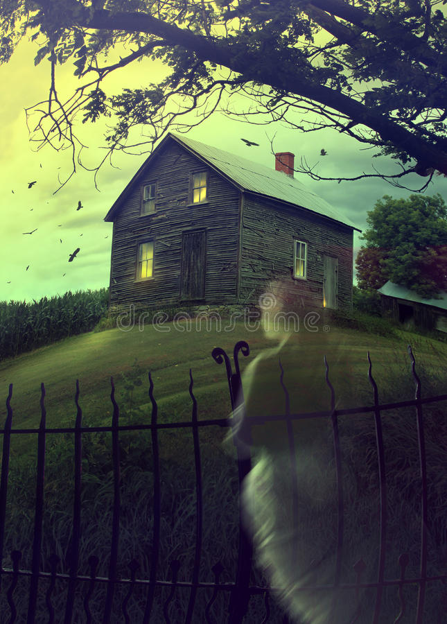 Abandoned haunted house on the hill with ghost royalty free stock photo
