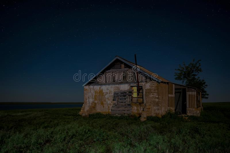 Night landscape with abandoned spooky house. Abandoned haunted house for night horror scene stock image