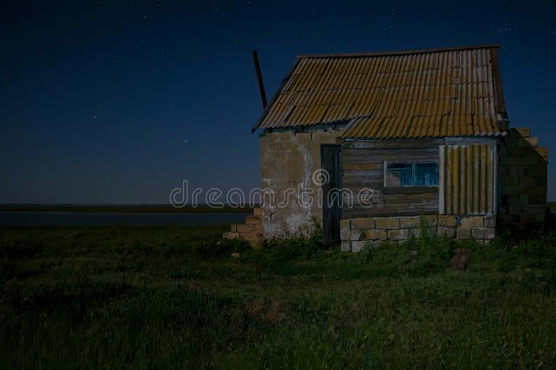 Night landscape with abandoned spooky house. Abandoned haunted house for night horror scene stock photos