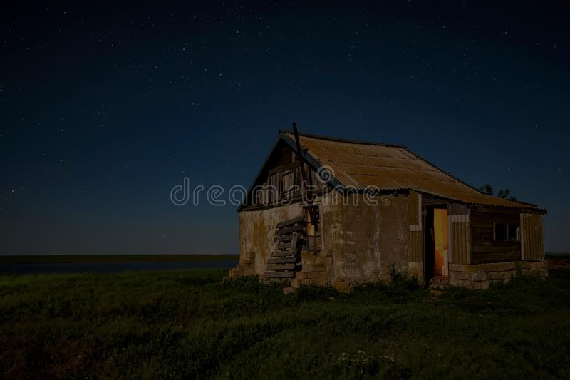 Night landscape with abandoned spooky house. Abandoned haunted house for night horror scene royalty free stock images