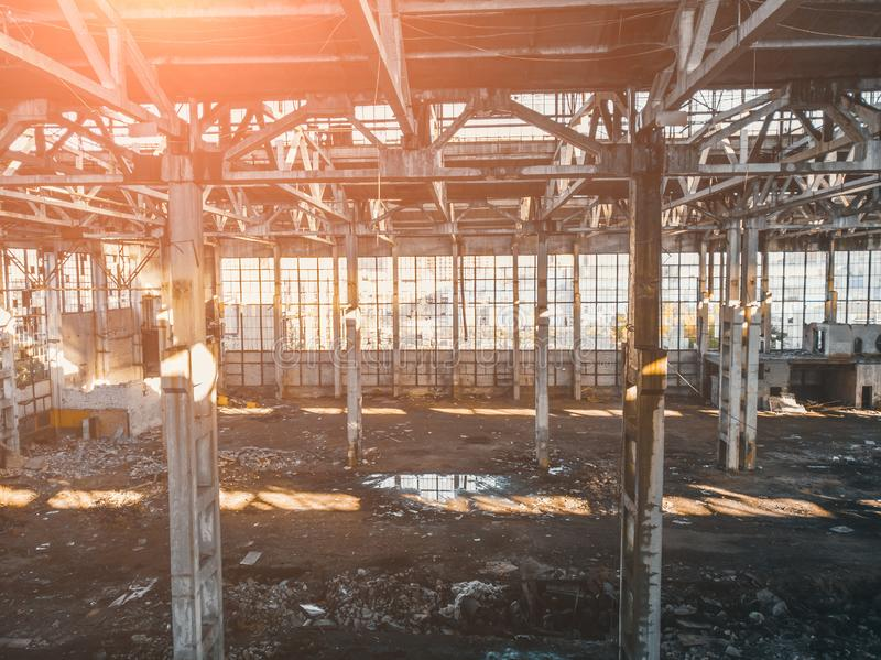 Abandoned and haunted industrial creepy warehouse inside, old ruined grunge factory building. Toned royalty free stock photo