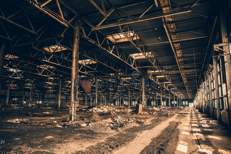 Abandoned and haunted industrial creepy warehouse inside, old ruined grunge factory building. Toned royalty free stock images