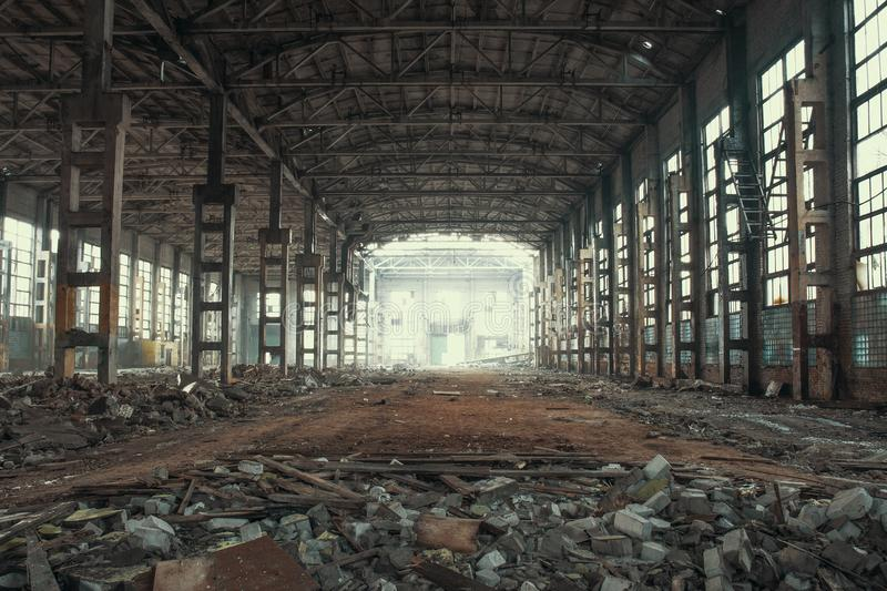 Abandoned and haunted industrial creepy warehouse inside, old ruined grunge factory building. Toned stock images