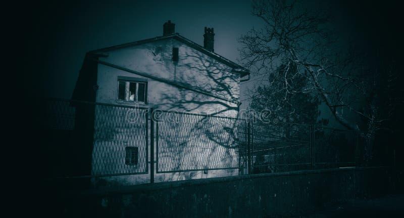 Abandoned horror house at night. Old abandoned horror house at night royalty free stock photos