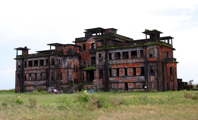 Abandoned hotel. Bokor Hill. Kampot. Cambodia. Abandoned hotel 'Bokor Palace' in Ghost town Bokor Hill station near the town of Kampot. Cambodia royalty free stock image