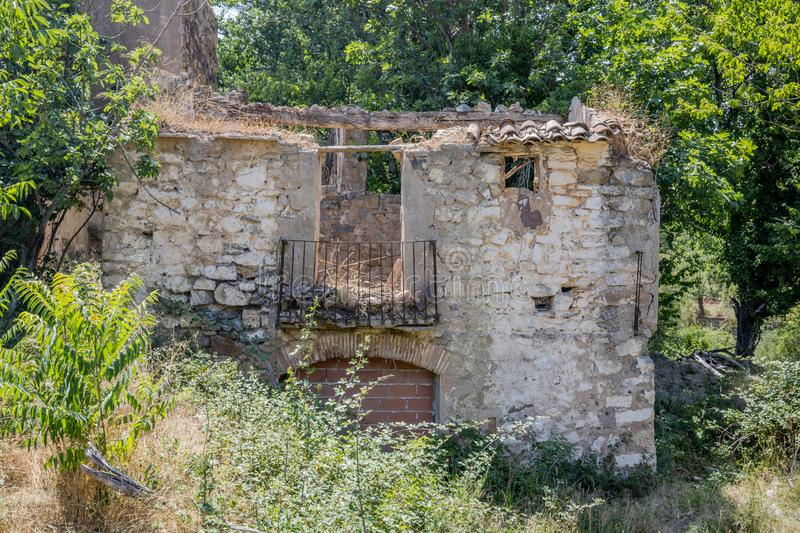 Abandoned house. On the bed of the Palancia river as it passes through Teresa, sky, natural, structure, exterior, wall, power, debris, construction royalty free stock photography