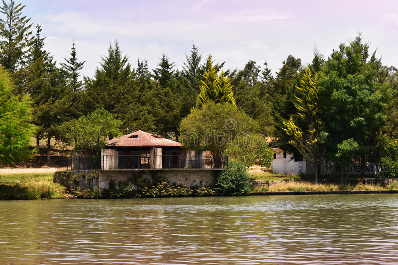 Abandoned house in the forest, on the edge of a lake royalty free stock images