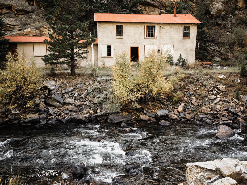 Abandoned House By Stream. Driving up the mountains going toward Black Hawk Colorado, located this abandoned home next to a babbling brook stock photos