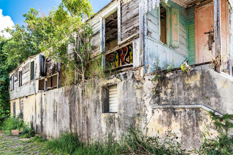 Abandoned house in urban area on the island of St. Croix. Disrepair and decay. Overgrown with vegetation stock image
