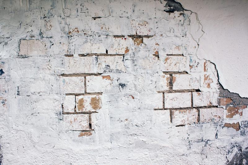 Abandoned house wall. Cracked brick wall stock images