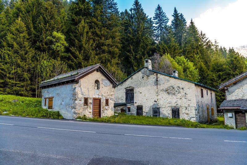 Abandoned houses near road and forest, Chamonix Mont Blanc, Haut. E-Savoie, Auvergne-Rhoene-Alpes, France stock photography