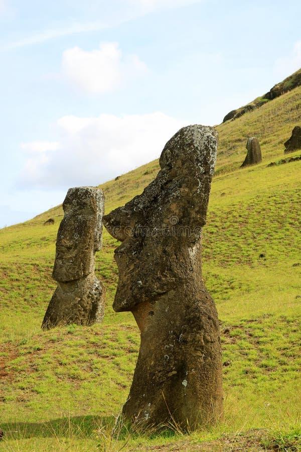 Abandoned huge Moai statues on the slope of Rano Raraku volcano, legendary Moai quarry on Easter Island, Chile. Abandoned huge Moai statues on the slope of Rano royalty free stock photography