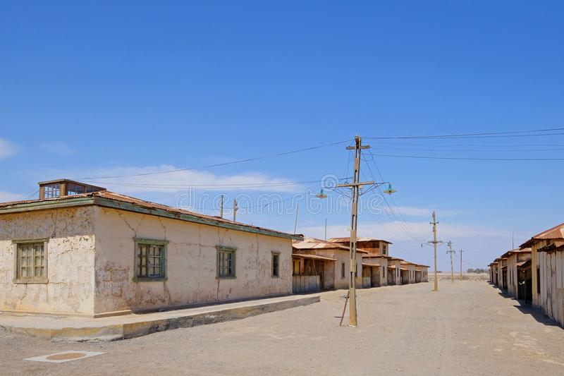 Abandoned Humberstone and Santa Laura saltpeter works factory, near Iquique, northern Chile, South America. This abandoned nitrate town was extremely important royalty free stock image
