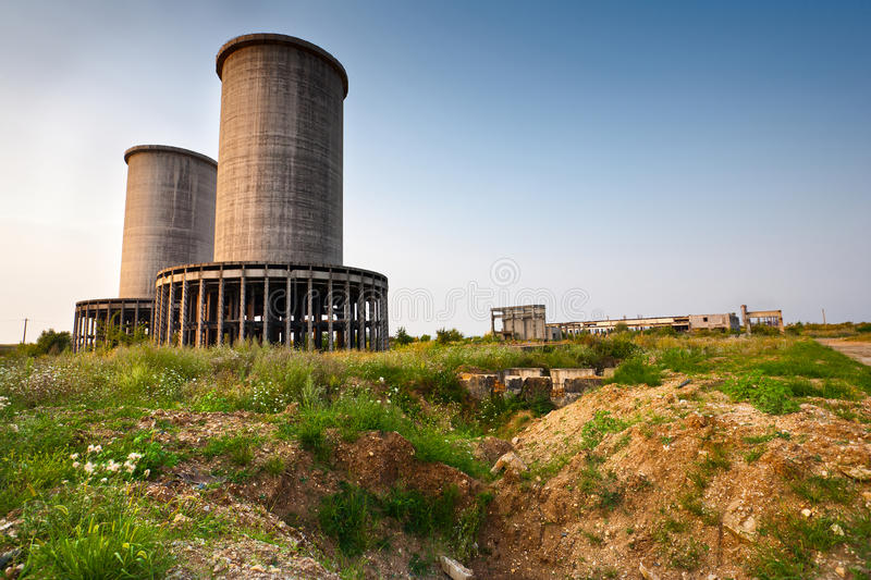 Abandoned industrial building. Landscape with abandoned industrial facilities under blue sky stock images