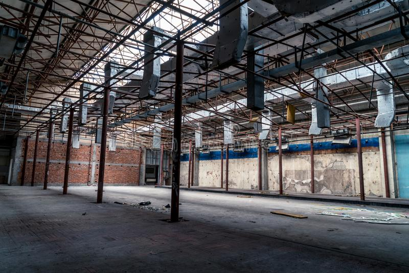 The abandoned industrial building. Fantasy interior scene royalty free stock photo
