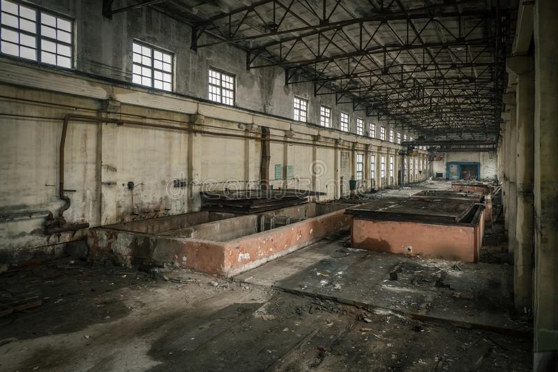 Abandoned industrial building interior. Former reinforced concrete factory.  royalty free stock photos