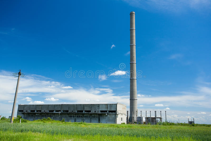 Abandoned industrial buildings. Landscape with abandoned industrial facilities under blue sky royalty free stock image
