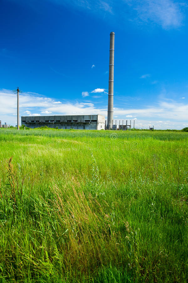 Abandoned industrial buildings. Landscape with abandoned industrial facilities under blue sky stock photo