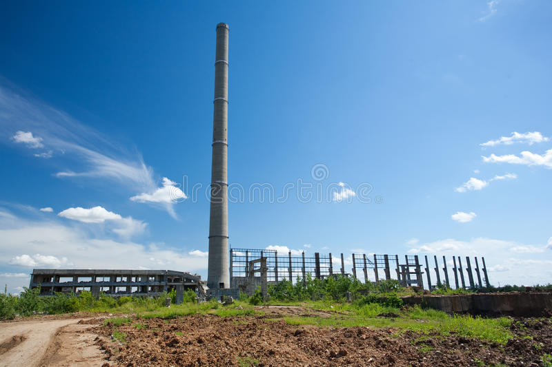 Abandoned industrial buildings. Landscape with abandoned industrial facilities under blue sky stock images