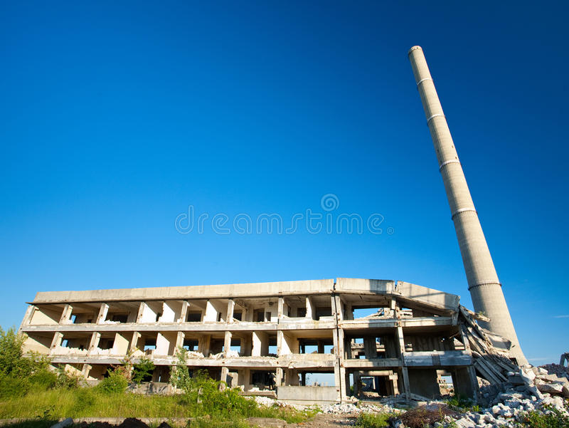 Abandoned industrial buildings. Landscape with abandoned industrial facilities under blue sky stock photos