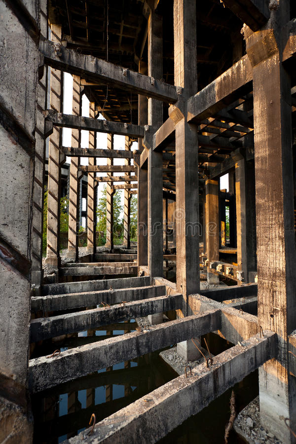 Abandoned industrial facility. Concrete structure of an abandoned or unfinished industrial building stock image