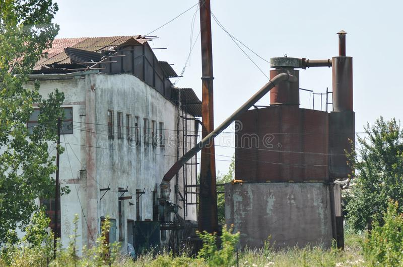 Abandoned industrial factory. Abandoned communist industrial factory on a summer day stock photos