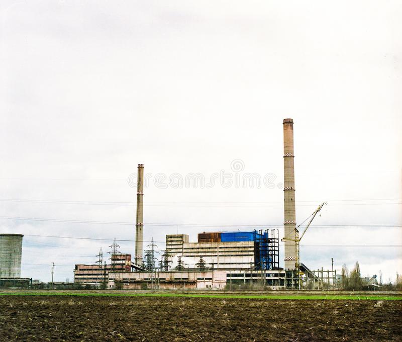 Abandoned industrial factory. In the field royalty free stock photo