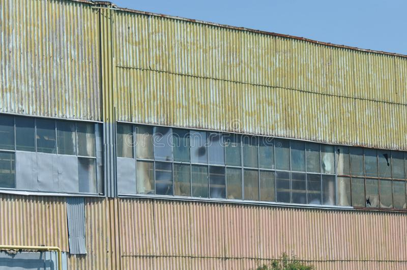 Abandoned industrial factory. Abandoned communist industrial factory on a summer day royalty free stock photos