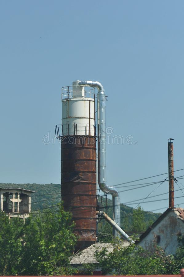 Abandoned industrial factory. Abandoned communist industrial factory on a summer day stock photography