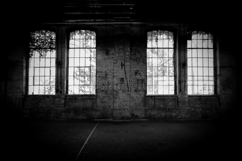 Abandoned industrial interior with bright light royalty free stock image