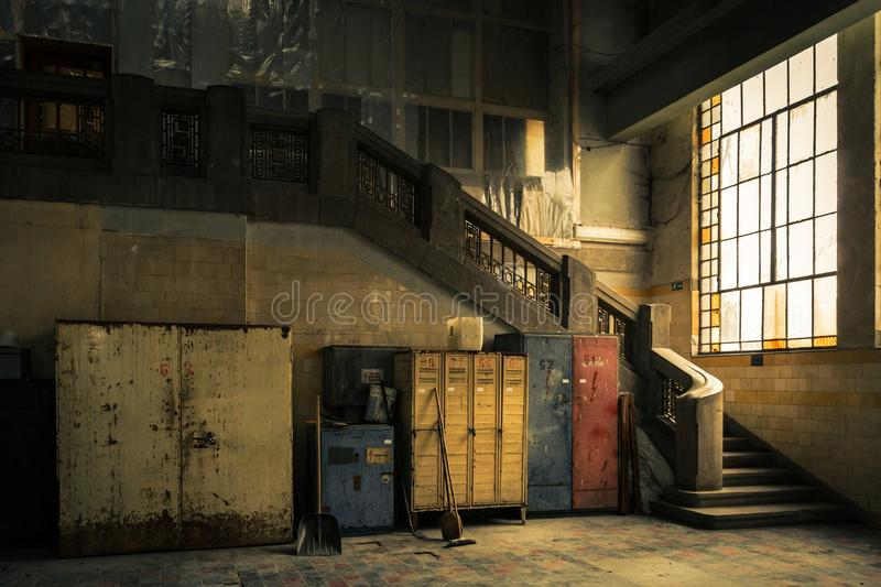 Abandoned industrial interior. With cupboard and stair royalty free stock photos