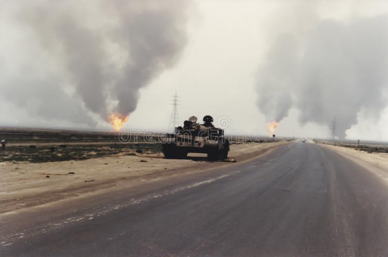 Abandoned Iraqi tank in Kuwait following Persian Gulf War. Historical image of abandonded tank on roadside of buring oil field in aftermath of Operation Desert royalty free stock photography