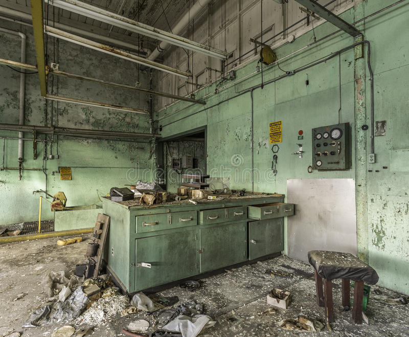 Abandoned laboratory in a factory. Green abandoned laboratory in an empty factory royalty free stock photo