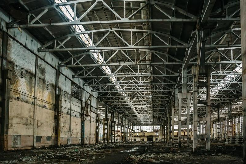 Abandoned large industrial hall or warehouse with garbage, manufactory factory stock images
