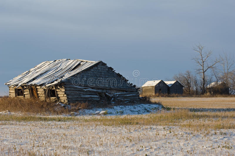 Abandoned log cabin in winter stock images