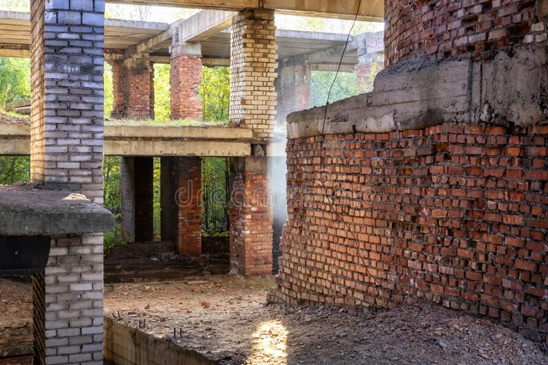 Abandoned during construction brick apartment building royalty free stock photo
